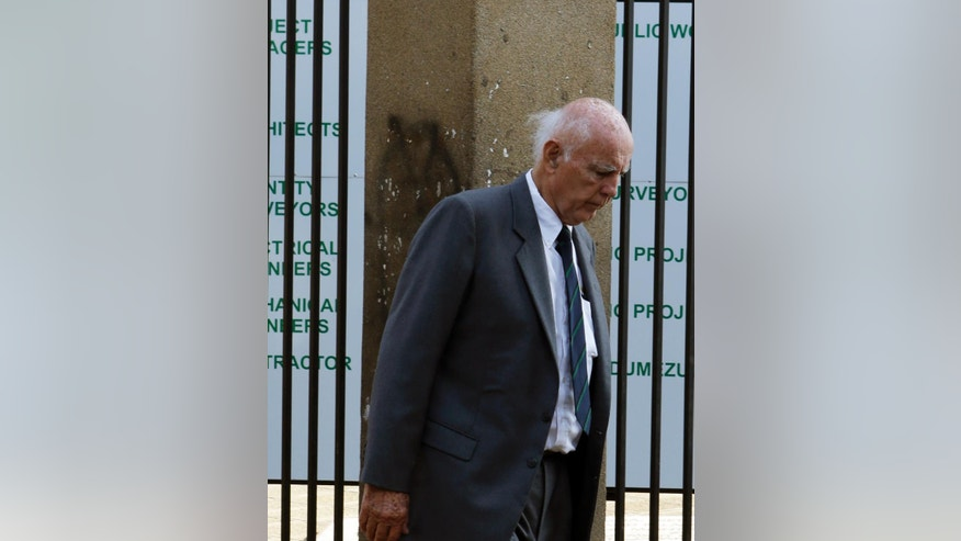 Retired tennis player Bob Hewitt leaves the court after his appeal was postponed at the high court in Pretoria, South Africa Tuesday, May 19, 2015.  Judge Bert Bam on Monday sentenced Hewitt to eight years in jail for two counts of rape, with two years suspended. He also sentenced Hewitt to two years in prison for a third charge of sexual assault. (AP Photo/Themba Hadebe)