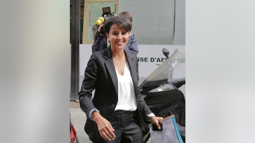 French education Minister Najat Vallaud-Belkacem arrives at  French local radio station to answers questions of  younger students,  in Paris, France. Tuesday, May 19 2015.  France's government, fearing that inequality among schoolchildren threatens the education system and the country's future, is proposing an overhaul that would end elite bilingual programs in middle school and give individual schools more say in how students spend their time. ( AP Photo/Jacques Brinon)