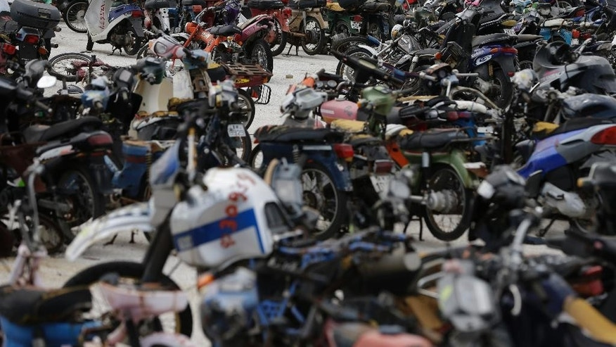 Hundreds of motorcycles are parked at the Public Property Management Organization (ODDY) during an auction in western Athens on Tuesday, May 19, 2015. The ODDY frequently auctions state and confiscated vehicles with hundreds of people trying to buy them at low prices. Greek Finance Minister Yanis Varoufakis said Monday that he expects an agreement with bailout creditors within the next week, which would save the cash-strapped country from fast-approaching bankruptcy. (AP Photo/Thanassis Stavrakis)