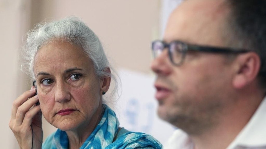 Reporters Without Borders secretary general Christophe Deloire, right, and Deborah Tice, mother of Austin Tice who is missing in Syria, hold a joint press conference, at the Press Club, in Beirut, Lebanon, Tuesday, May 19, 2015. Journalist Austin Tice, of Houston, Texas, disappeared in August 2012 while covering Syria's civil war. It's not clear what entity is holding him, but it is not believed to be the Islamic State group or the Syrian government, his family has said. (AP Photo/Bilal Hussein)