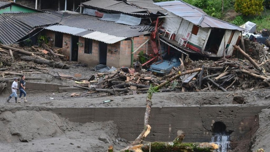 Houses damaged during an avalanche in Salgar, in Colombia's northwestern state of Antioquia, Tuesday, May 19, 2015. The avalanche of mud and debris roared through the mountain town before dawn Monday, taking away homes and bridges. Authorities said the death toll, which had risen to 62, was likely to grow throughout the day as an undetermined number of people remain missing. (AP Photo/Luis Benavides)