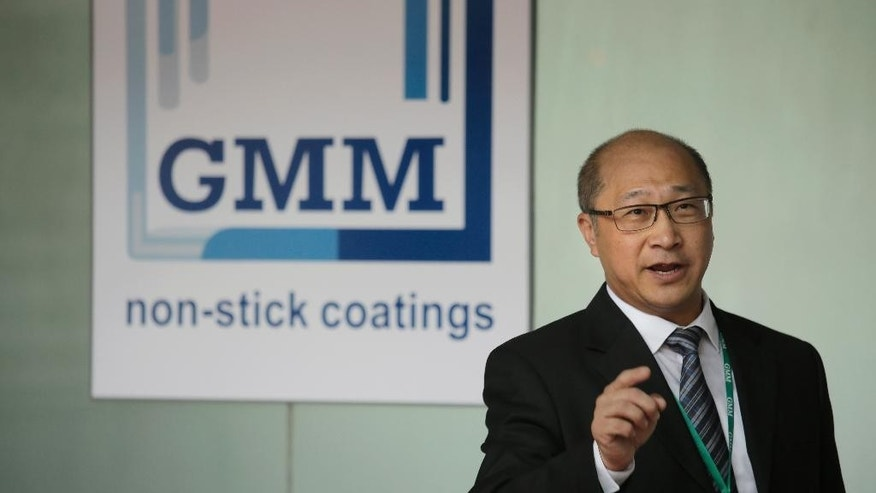 In this Wednesday, May 6, 2015 photo, Raymond Chung, general manager and co-founder of GMM non-stick coatings factory, poses after an interview in Zhuhai, southern coast of Guangdong province, China. In China, where the yuan has risen in tandem with the dollar because of Beijing's tight control, manufacturers like GMM, which has a factory in Zhuhai and another in India, are losing some overseas sales. (AP Photo/Vincent Yu)