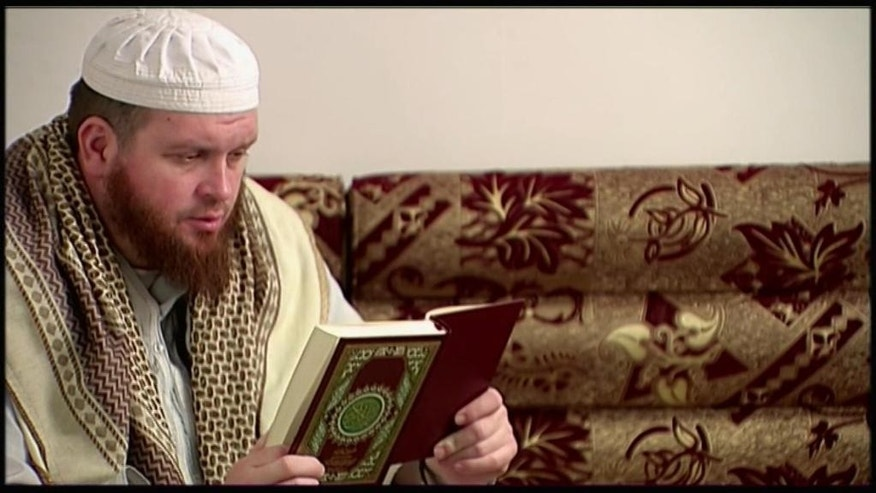 This image provided by New Zealand 3 News/MediaWorks via APTN shows Mark Taylor, who converted to Islam and is now thought to be in Syria, as he reads the Quran in his native New Zealand. Taylor, 42, began visiting a mosque in the city of Hamilton some years ago, and resurfaced 2014 in Syria. Authorities estimate only a half-dozen New Zealanders have traveled to Syria to fight with the Islamic State group. It's unclear how they've become radicalized, although Taylor's case might provide a clue: He's acknowledged listening to the sermons of the late U.S.-born al-Qaida preacher Anwar al-Awlaki.  (New Zealand 3 News/MediaWorks via APTN)  AUSTRALIA OUT; NEW ZEALAND OUT