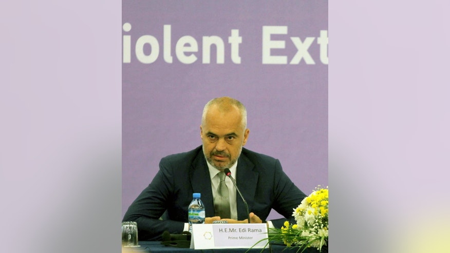 "Albanian prime minister Edi Rama speaks at a U.S.-sponsored anti-terrorism regional meeting in Albania's capital Tirana, Wednesday, May 20, 2015. Rama warned Macedonia it cannot join the NATO family unless it respects the democratic rights of its ethnic Albanian minority, considering ""unacceptable"" how Macedonian authorities linked a recent gunbattle between police and a group of armed ethnic Albanian men as a terrorist act from the latter. (AP Photo/Hektor Pustina)"