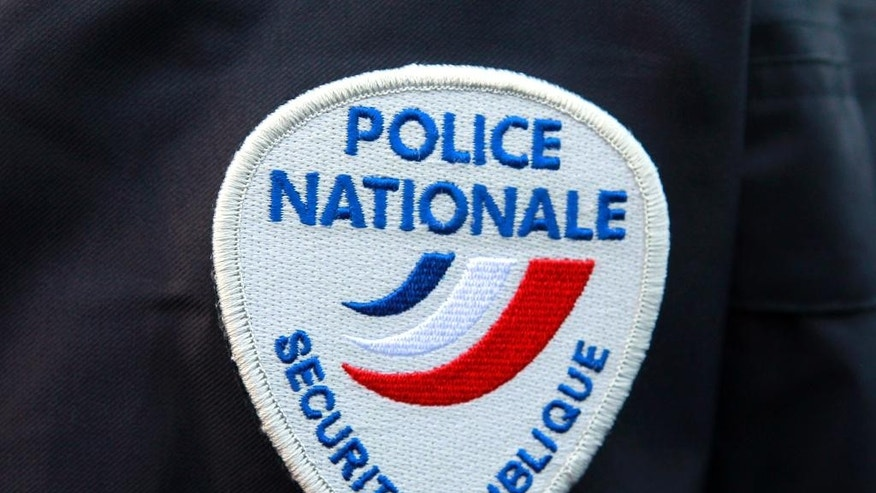 FILE - This March 18, 2015 file photo shows the logo of the French national police during a ceremony in homage to the police officers killed during the Jan. 7, terrorist attacks in Paris, at the Police School of Cannes-Ecluses, south of Paris. Fearful of an expanding extremist threat, countries that for years have relied heavily on U.S. intelligence are quickly building up their own capabilities with new technology, new laws and _ in at least one case _ a searing debate on how much the American government should be allowed to spy on their own citizens. (AP Photo/Remy de la Mauviniere, File)