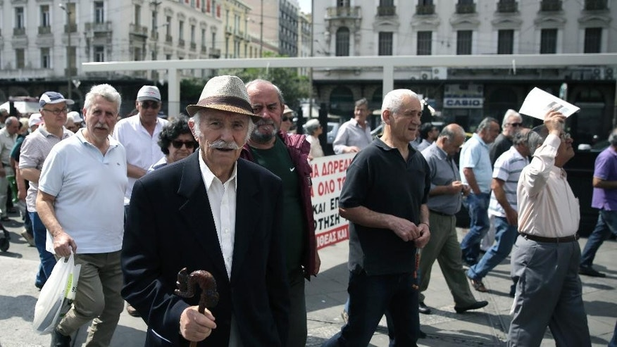 Pensioners take part in an anti austerity protest in central Athens, on Wednesday, May 20, 2015. Greece's new government has been struggling to agree on reforms that creditors require in return for funds from the country's bailout needed to avoid defaulting on debts due next month.(AP Photo/Petros Giannakouris)