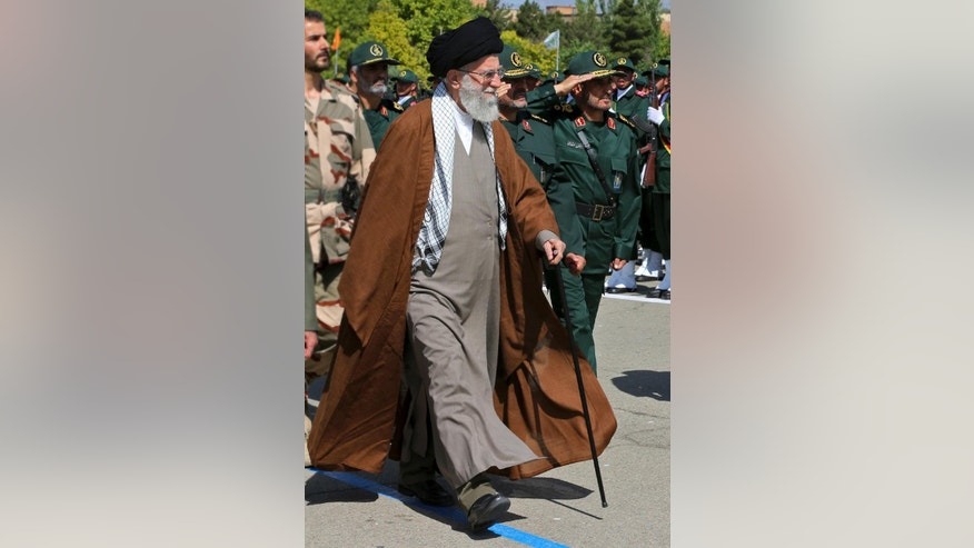 In this picture released by an official website of the office of the Iranian supreme leader on Wednesday, May 20, 2015, Supreme Leader Ayatollah Ali Khamenei reviews Revolutionary Guard cadets in a graduation ceremony in Tehran, Iran. Iran's supreme leader vowed Wednesday he will not allow international inspection of Iran's military sites or access to Iranian scientists under any nuclear agreement with world powers. (Office of the Iranian Supreme Leader via AP)