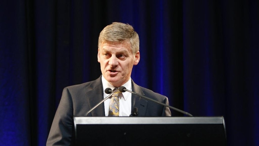 New Zealand's Finance Minister Bill English delivers his budget speech to analysts and reporters in Wellington, New Zealand, Thursday, May 21, 2015. New Zealand's government on Thursday blamed low inflation for its failure to deliver a promised budget surplus this year but said it remains on target to get its books into the black next year. (AP Photo/Nick Perry)
