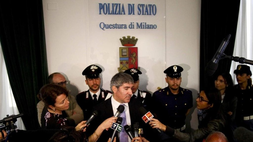 Milan chief anti-terrorism investigator Bruno Megale, center, speaks during a press conference in Milan, Italy, Wednesday, May 20, 2015. Police say Abdelmajid Touil, the Moroccan man arrested in connection with the Tunisian museum attack, had arrived in Italy aboard a migrant boat a month before the attack and was ordered expelled. (Mourad Balti Touati/ANSA via AP)