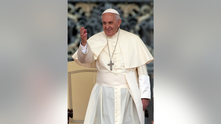 Pope Francis waves to faithful during his weekly general audience, in St. Peter's Square, at the Vatican, Wednesday, May 20, 2015. (AP Photo/Andrew Medichini)