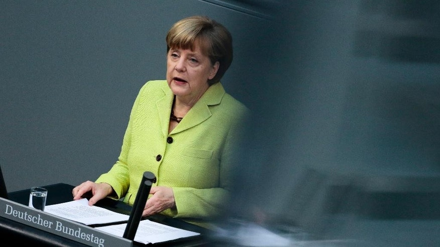 German Chancellor Angela Merkel delivers a government declaration about the European Union and an Eastern Partnership with former Soviet Republics at the German parliament Bundestag in Berlin, Germany, Thursday, May 21, 2015. Merkel will attend a summit of the European Union and former Soviet Republics in Latvia's capital Riga in the afternoon. (AP Photo/Markus Schreiber)