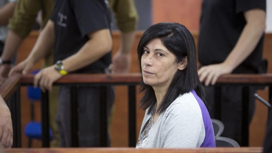 Palestinian Parliament member  Khalida Jarrar of the Popular Front for the Liberation of Palestine (PFLP) attends a court session at the Israeli Ofer military base near the West Bank city of Ramallah, Thursday, May 21, 2015. An Israeli military court has ruled that Palestinian legislator Khalida Jarrar should be released on bail, but has ordered her held for at least three more days while the prosecutor decides whether to appeal.  Jarrar, 52, was seized from her West Bank home in pre-dawn army raid on April 2. She has been charged with membership in a small leftist PLO faction banned by Israel and with inciting violence.  (AP Photo/Majdi Mohammed)