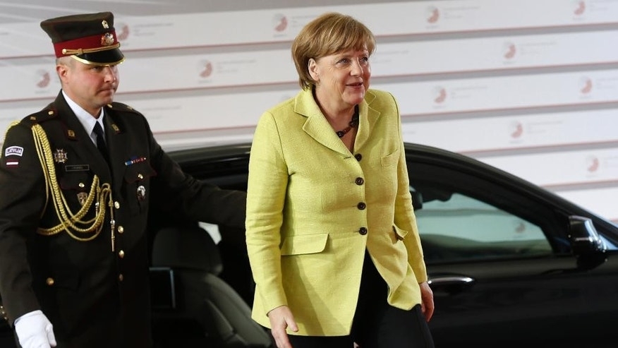 German Chancellor Angela Merkel arrives for a formal dinner at the Eastern Partnership summit in Riga, on Thursday, May 21, 2015. EU leaders on Thursday will seek new ways to bolster ties with six post-communist nations in Eastern Europe, a year and a half after a previous summit of the Eastern Partnership ended with a fateful standoff over Ukraine. (AP Photo/Mindaugas Kulbis)