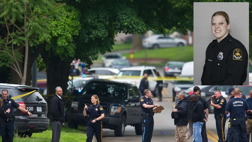Law enforcement officers gather near the scene of a shooting Wednesday, May 20, 2015 in Omaha, Neb. Police say one female officer and at least one other person were shot and are being treated at an Omaha hospital. Inset: Photo provided by the Omaha Police Department shows officer Kerrie Orozco (Chris Machian/Omaha World-Herald via AP)