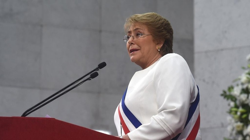 In this photo released by Chile's presidential press office, Chile's President Michelle Bachelet gives her annual address to Congress in Valparaiso, Chile. Bachelet announced that in September, a constitutional process will begin in order to replace the nation's constitution, which is from the era of Chile's late dictator Augusto Pinochet. (Alex Ibanez, Chile Presidential Press Office, via AP)