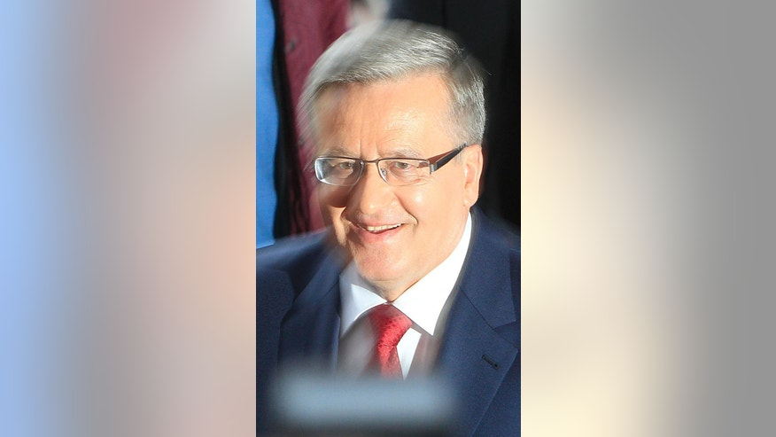 Polish president Bronislaw Komorowski arrives to take part in the second debate at a tv studio with opposition candidate Andrzej Duda ahead of the May 24 presidential runoff  in Warsaw, Poland, Thursday, May 21, 2015. (AP Photo/Czarek Sokolowski)