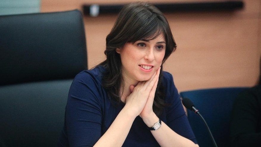 In this photo taken March 13, 2012, Knesset member Tzipi Hotovely sits in the Knesset, Israel's parliament, in Jerusalem. on Thursday, May 21, 2015 Hotovely, Israel's new deputy foreign minister, delivered a defiant message to the international community on Thursday, May 21, 2015, saying that Israel owes no apologies for its policies in the Holy Land and citing religious texts that it belongs to the Jewish people. (AP Photo/Emil Salman)