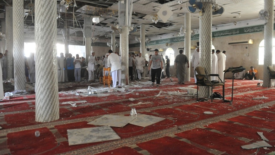 May 22, 2015 - Family members of victims and well wishers are seen after a suicide bomb attack at the Imam Ali mosque in the eastern province of Qatif, Saudi Arabia. A suicide bomber blew himself up at the Shiite mosque in during Friday prayers, residents said.
