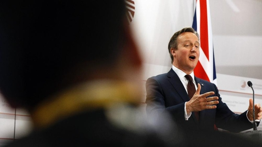 British Prime Minister David Cameron, right, speaks during a media conference at the conclusion of the Eastern Partnership summit in Riga, Latvia on Friday, May 22, 2015. EU leaders gathered for a second day of meetings with six post-communist nations to discuss various issues, including enlargement, the economy and Ukraine. (AP Photo/Mindaugas Kulbis)