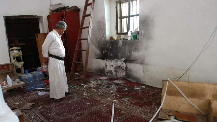 May 22, 2015 - A man inspects damage caused by a bomb explosion at a mosque in Sanaa, Yemen. The Saudi-led coalition on Friday launched heavy airstrikes on Shiite rebels in Yemen, targeting camps and weapons depots in the rebel-held capital, Sanaa.
