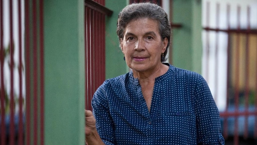 "Maria Luisa de Martinez poses for photos at her home in San Salvador, El Salvador, Thursday, May 21, 2015. De Martinez is the sister of Roberto d'Aubuisson, the man widely believed to have ordered the Roman Catholic Archbishop Oscar Romero's 1980 assassination. In 1979 de Martinez learned that her brother belonged to a paramilitary group called ORDEN, or ""order,"" whose mission was to identify and eliminate supposed communists in rural communities. (AP Photo/Moises Castillo)"