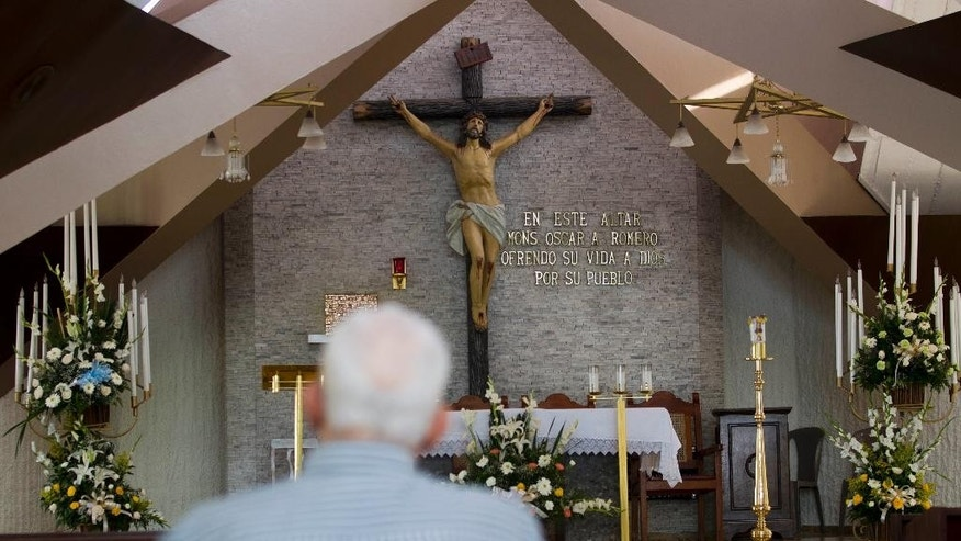 A man sits inside a Cancer Hospital Chapel, where Roman Catholic Archbishop Oscar Arnulfo Romero was killed as he celebrated Mass on March 24, 1980, in San Salvador, El Salvador, Thursday, May 21, 2015. Romero was killed by a sniper's bullet believed to have been fired from a car outside. The assassination came a day after he made a bold and public demand that soldiers stop repressing civilians. Nobody was ever prosecuted for the killing, and the gunman has not been identified. (AP Photo/Moises Castillo)