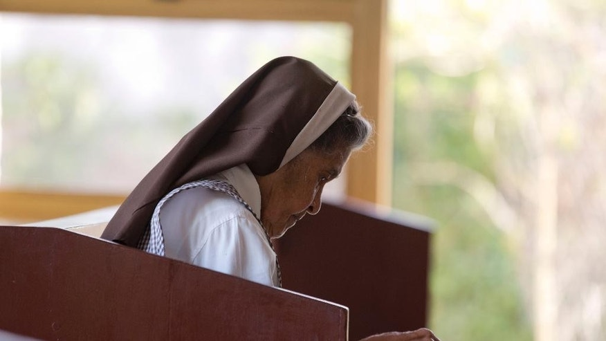 A nun reads siting inside a Cancer Hospital Chapel, where Roman Catholic Archbishop Oscar Arnulfo Romero was killed as he celebrated Mass on March 24, 1980, in San Salvador, El Salvador, Thursday, May 21, 2015. Romero was killed by a sniper's bullet believed to have been fired from a car outside the Chapel. The assassination came a day after he made a bold and public demand that soldiers stop repressing civilians. Nobody was ever prosecuted for the killing, and the gunman has not been identified. (AP Photo/Moises Castillo)