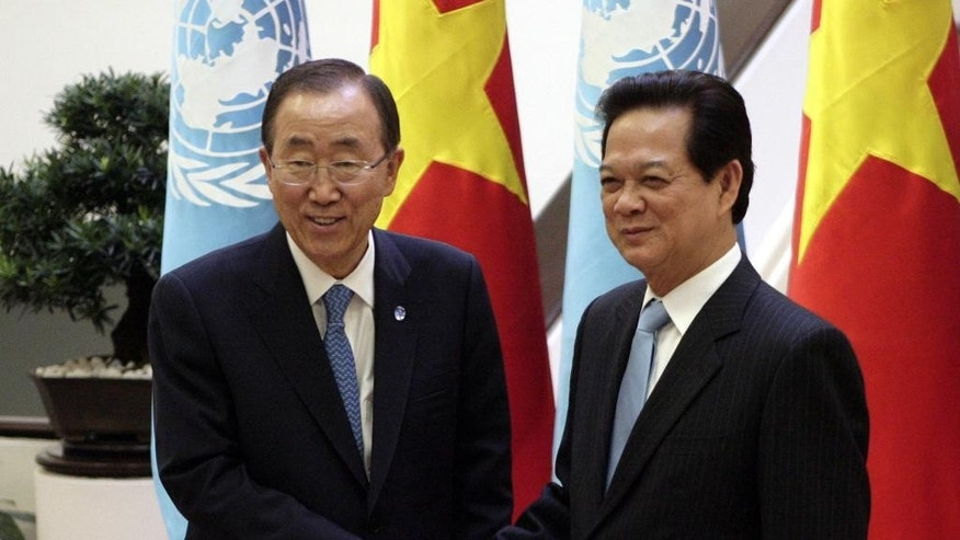 U.N. Secretary-General Ban Ki-moon, left, shakes hands with Vietnamese Prime Minister Nguyen Tan Dung in Hanoi, Vietnam Friday, May 22, 2015. Ban, who was on a two-day visit to Vietnam, called for peaceful solutions to territorial disputes in the South China Sea, where China's assertiveness has alarmed its smaller neighbors. (AP Photo/Tran Van Minh)