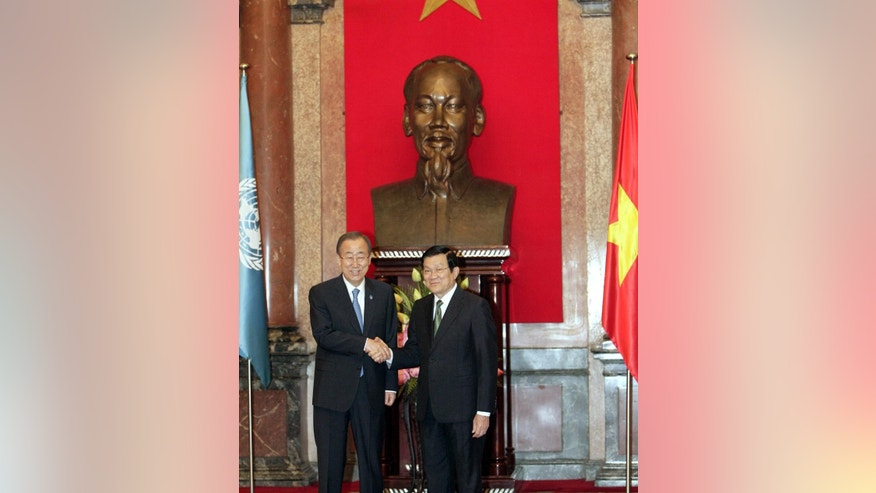 UN Secretary General Ban Ki-moon shakes hands with Vietnamese President Truong Tan Sang in Hanoi, Vietnam on Friday, May 22, 2015. Ban is on a two-day visit to Vietnam where he called for peaceful solutions to the disputes in the South China Sea. (AP Photo/Tran Van Minh.)