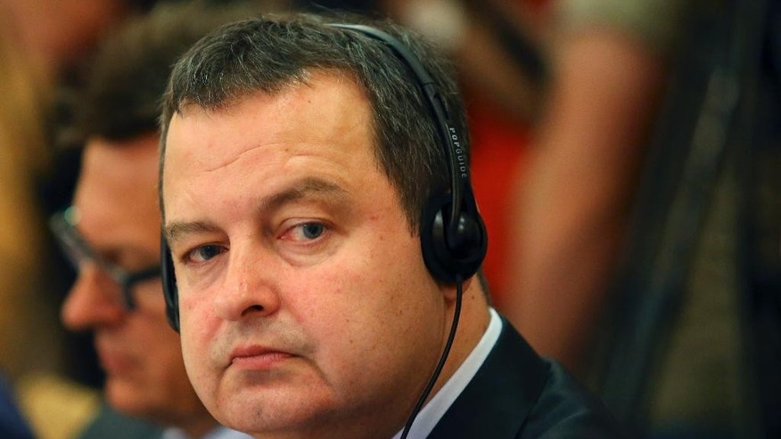 Serbian Foreign Minister Ivica Dacic takes part in a regional meeting of Southeast European countries in Tirana, Albania Friday, May 22, 2015. Western Balkan countries are urged from the European Union ti strengthen their regional cooperation along their steps to join the bloc. (AP Photo/Hektor Pustina)