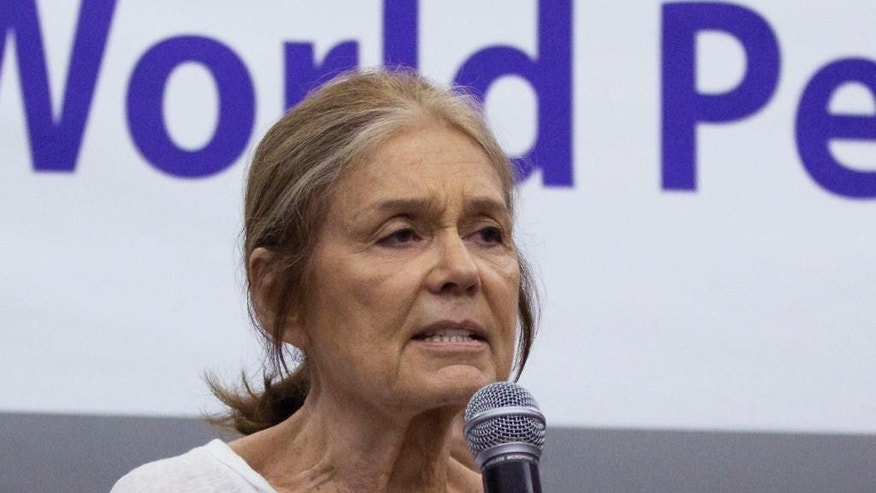 FILE - In this May 19, 2015 file photo, U.S. activist Gloria Steinem speaks among the members of the Women Cross DMZ group during a press conference before they leave for Pyongyang, at a hotel in Beijing, China. Steinem and a group of 29 other women from 15 countries are set to walk across the Demilitarized Zone dividing North and South Korea on Sunday, May 24 after obtaining a rare green light from both governments. (AP Photo/Andy Wong, File)