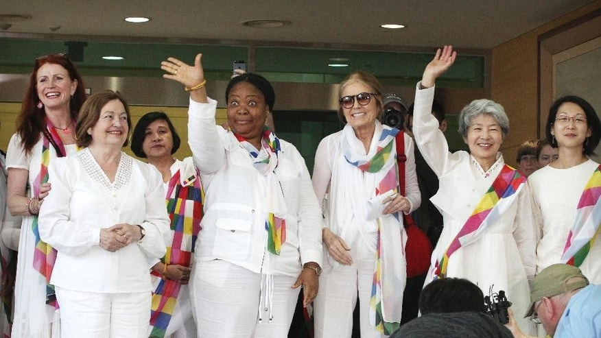 From second left, Nobel Peace Prize laureates Mairead Maguire and Leymah Gbowee, U.S. activist Gloria Steinem and other woman activists smile upon their arrival from North Korea at the office of the customs, immigration and quarantine in Paju, South Korea, near the border village of Panmunjom, Sunday, May 24, 2015. International women activists including Steinem and two Nobel Peace laureates on Sunday were denied an attempt to walk across the Demilitarized Zone dividing North and South Korea, but were allowed to cross by bus and complete what one of them called a landmark peace event.(AP Photo/Ahn Young-joon)
