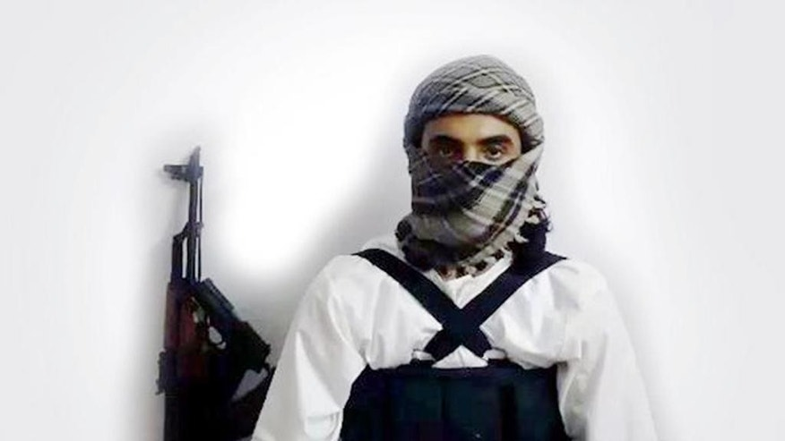 "This image taken from a militant website associated with Islamic State extremists, posted Saturday, May 23, 2015, purports to show a suicide bomber identified as a Saudi citizen with the nom de guerre Abu Amer al-Najdi who carried out an attack on a Shiite mosque. The Islamic State group's radio station has claimed responsibility for that suicide bombing Friday, warning that more ""black days"" loom ahead for Shiites. The attack killed at least 21 people and wounded dozens in the village of al-Qudeeh in the eastern Qatif region as worshippers commemorated the birth of a revered saint. The Arabic bar below reads: ""Urgent: The heroic martyr Abu Amer al-Najdi, the attacker of the (Shiite) temple in Qatif."" (Militant photo via AP)"