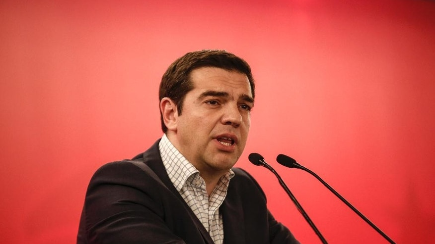 "Greece's Prime Minister Alexis Tsipras addresses the audience during a Syriza party central committee meeting in Athens, Greece, on Saturday, May 23, 2015. Tsipras has told leaders of the governing Radical Left Coalition that Greece is ready to accept a ""viable and long lasting"" deal with its lenders, but not on ""humiliating terms."" (AP Photo/Yorgos Karahalis)"