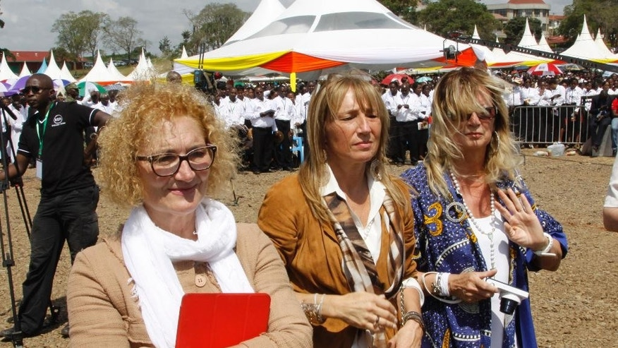 "Descendants of Blessed Sister Irene Gabriella Guerni, left, Patrizia  Guerini, second left and Stefenia Guerini attend her beatification ceremony in Nyeri. Nairobi, Kenya Saturday, May. 23. 2015. Tens of thousands of people have gathered in the central Kenyan town of Nyeri to attend the beatification ceremony of a beloved Italian nun who worked for many years in the East African nation. Kenya's Daily Nation newspaper reported Saturday that up to 100,000 people from all over the world were in Nyeri Saturday to witness the ceremony during which Sister Irene Stefani was declared ""Blessed Irene."" Irene, who belonged to the Consolata Missionary Sisters, first came to Kenya in 1915 and died there in 1930 at the age of 39, according to a website dedicated to her beatification. (AP Photo/Khalil Senosi)"