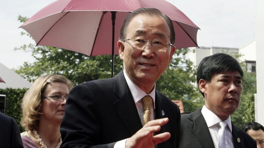 "U.N. Secretary-General Ban Ki-moon, center, waves to reporters as he arrives at the U.N. complex in Hanoi, Vietnam Saturday, May 23, 2015. Ban called for addressing the crisis that causes the flight of the Rohingya migrants. ""At the same time, it's important to save human lives,"" he said on a visit to Hanoi, Vietnam. Ban said he has been in discussion with regional leaders in Myanmar, Malaysia and Thailand, among others, to urge them to provide search and rescue operations and options for resettlement and reintegration. Ban said it was important ""not to send them back to a dangerous circumstance or situation."" (AP Photo/Tran Van Minh)"