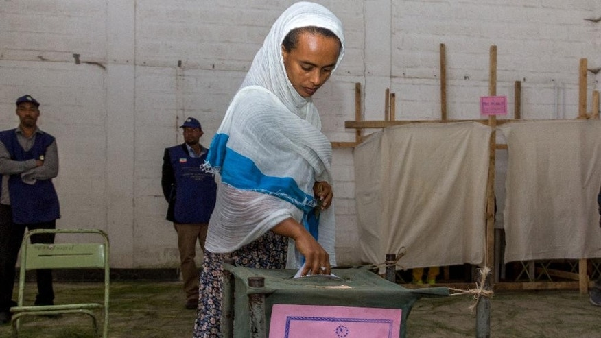 A woman casts her vote in Ethiopia's general election in Addis Ababa, Ethiopia, Sunday, May 24, 2015. Ethiopians voted Sunday in national and regional elections, the country's first since the 2012 death of its longtime leader, but the ruling party is expected to maintain its iron-clad grip on power. (AP Photo/Mulugeata Ayene)