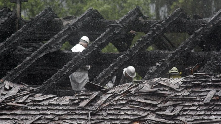 In this Saturday May 23, 2015 picture firefighters  investigate the roof of a house  in the Bavarian town of Schneizlreuth , Germany. Police in Germany say they have recovered the bodies of six people killed in the fire at the  guesthouse in the Alps. The men were among a group of 47 employees of the Bavarian construction company Lindner who had been staying at the converted farmhouse in Schneizlreuth, southeast of Munich. Forty-one people managed to flee the fire, which broke out in the early hours of Saturday. Seven people were hospitalized with serious injuries.  ( Ferdinand Farthofer/aktivnews/dpa  via AP)
