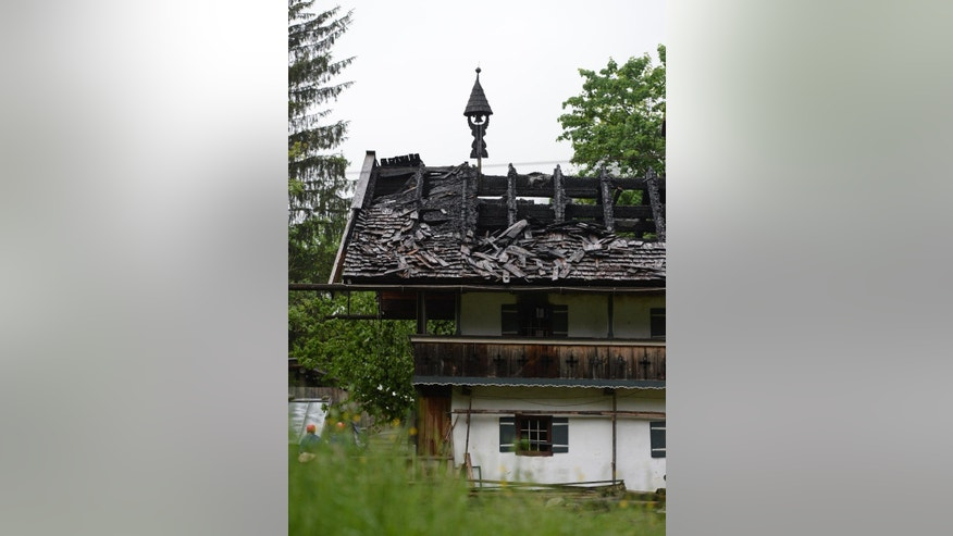 The destroyed roof of a house  in the Bavarian town of Schneizlreuth , Germany is photographed  Sunday May 24, 2015. Police in Germany say they have recovered the bodies of six people killed in the fire at the  guesthouse in the Alps. The men were among a group of 47 employees of the Bavarian construction company Lindner who had been staying at the converted farmhouse in Schneizlreuth, southeast of Munich. Forty-one people managed to flee the fire, which broke out in the early hours of Saturday. Seven people were hospitalized with serious injuries.  ( Andreas Gebert/dpa  via AP)