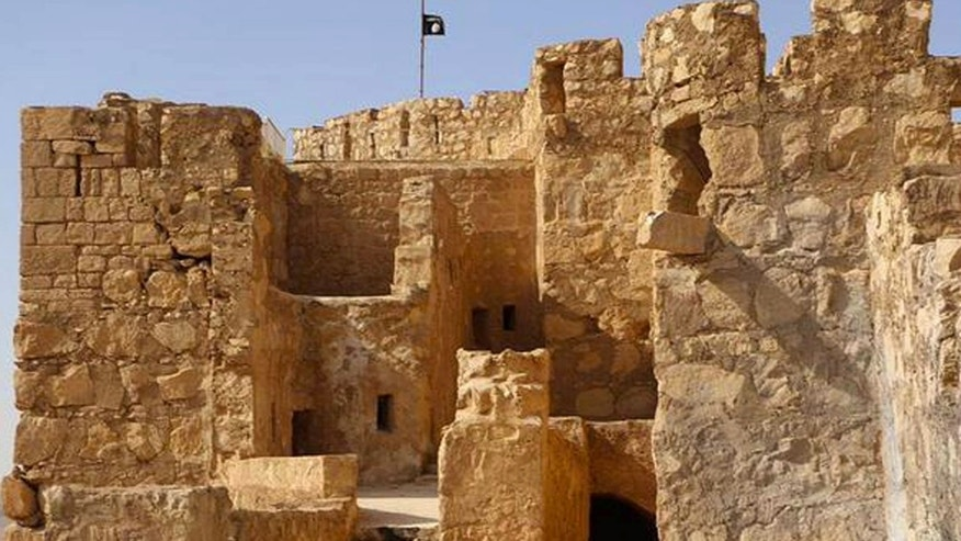 May 22, 2015: In this picture released by the website of Islamic State militants, shows the Islamic State militants flag, top center, raised on the to top of Palmyra castle, in the Syrian town of Palmyra