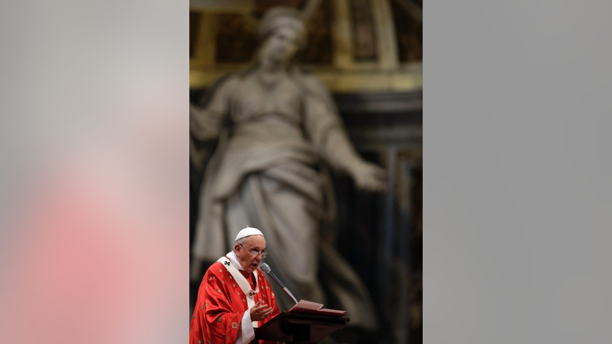 Pope Francis delivers his speech as he celebrates a mass of Pentecost in St. Peter's Basilica, at the Vatican, Sunday, May 24, 2015. (AP Photo/Gregorio Borgia)