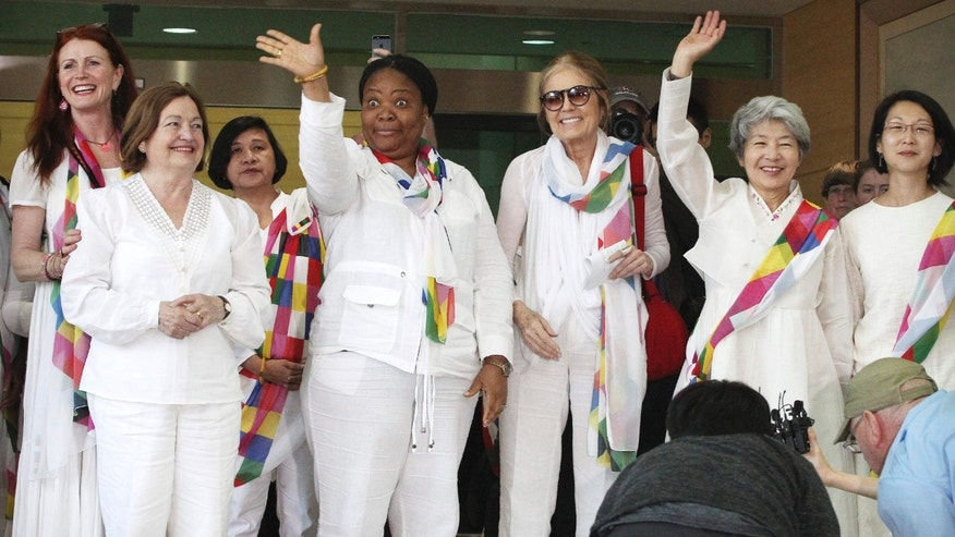May 24, 2015: From second left, Nobel Peace Prize laureates Mairead Maguire and Leymah Gbowee, U.S. activist Gloria Steinem and other woman activists smile upon their arrival from North Korea at the office of the customs, immigration and quarantine in Paju, South Korea, near the border village of Panmunjom.