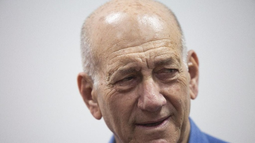 Former Israeli Prime Minister Ehud Olmert attends his trial at the Jerusalem District Court, Monday, May 25, 2015. Olmert was sentenced Monday to eight months in prison for unlawfully accepting money from a U.S. supporter, capping the dramatic downfall of a man who only years earlier led the country and hoped to bring about a historic peace agreement with the Palestinians. (Heidi Levine/Pool Photo via AP)
