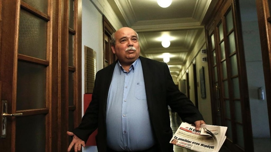 File- This May 12, 2015, file photo shows Greek Minister of Interior and Administrative Reconstruction Nikos Voutsis arriving for a cabinet meeting at the parliament in Athens. Greece will continue paying its debts, after its ruling Radical Left Coalition narrowly rejected a call by party hardliners to miss its next International Monetary Fund loan payment. Voutsis, a senior Syriza member who doesn't belong to the Left Platform, said in a TV interview Sunday, May 24, 2015, that Greece can't pay the IMF installments. (AP Photo/Petros Giannakouris, File)