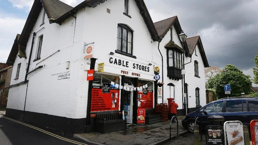 This photo taken on Tuesday, May 19, 2015, shows the post office and village store in Harmondsworth in London.  Residents of the village close to Heathrow Airport are campaigning against the expansion of the airport which they claim will decimate their community.  (AP Photo/Kirsty Wigglesworth)
