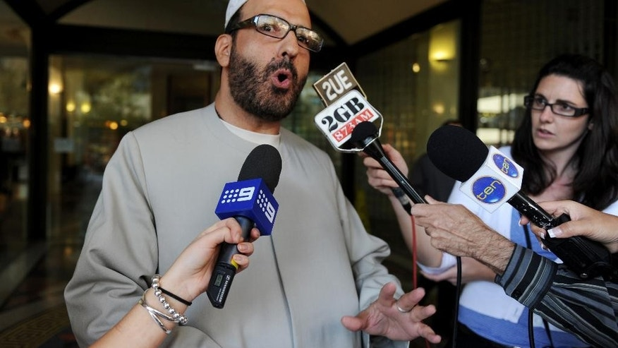 FILE - In this April 18, 2011 file photo, Man Haron Monis speaks to the media as he leaves the Downing Centre in Sydney after a pre-trial hearing where he is accused of sending offending letters to the families of soldiers killed in Afghanistan. The man who took 18 people hostage at a Sydney cafe last year was educated and erratic, secretive about his own life and public about his many grievances, and a self-obsessed fabulist who grew increasingly defiant as he edged closer to launching his deadly attack, lawyers told an inquest Monday, May 25, 2015. (Dean Lewins/AAP Image via AP, File) AUSTRALIA OUT, NEW ZEALAND OUT, NO ARCHIVE, NO SALES