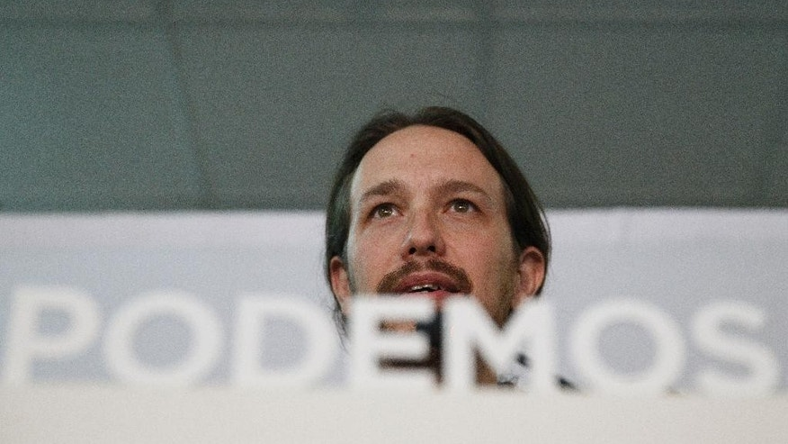 Pablo Iglesias, leader of the Podemos (We Can) party gives a speech to celebrate the party results after the elections and in support of local candidate for Ahora Madrid (Madrid Now) party in Madrid, Spain, Sunday, May 24, 2015. Ahora Madrid stood for the Madrid municipal elections to seek an end nearly four decades of dominance by the conservative Popular Party and the center-left Socialists.(AP Photo/Daniel Ochoa de Olza)
