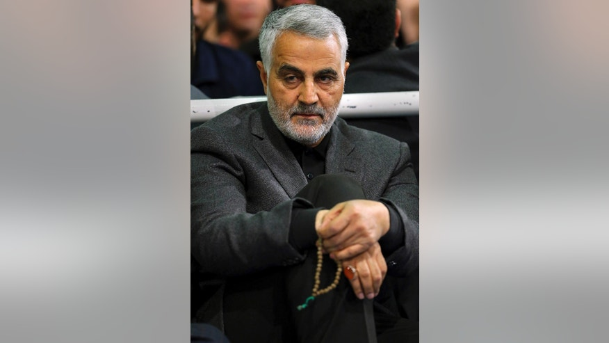 "FILE - In this Friday, March 27, 2015 file photo released by an official website of the office of the Iranian supreme leader, commander of Iran's Quds Force, Qassem Soleimani, sits in a religious ceremony at a mosque in the residence of Supreme Leader Ayatollah Ali Khamenei, in Tehran, Iran. The chief of an elite unit in Iran's Revolutionary Guard has accused the U.S. of having ""no will"" to stop the Islamic State group after the fall of the Iraqi city of Ramadi, an Iranian newspaper reported Monday, May 25, 2015. (Office of the Iranian Supreme Leader via AP, File)"