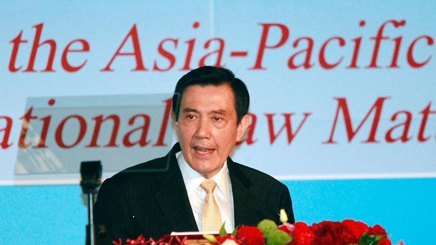 Taiwan's President Ma Ying-jeou speaks as he announces his South China Sea Peace Initiative during the 2015 ILA-ASIL Asia Pacific Research Forum in Taipei, Taiwan, Tuesday, May 26, 2015. President Ma laid out a plan Tuesday to ease tensions in a vast, resource-rich Asian ocean where China has chafed against its neighbors by expanding islets with landfill to solidify its claims in the region. (AP Photo/Wally Santana)
