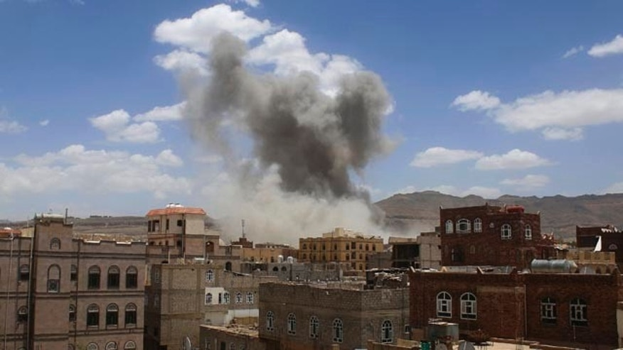 May 24, 2015: Smoke rises after a Saudi-led airstrike targeted a military base in Sanaa, Yemen. Fighting raged on in Yemen on Sunday, with airstrikes by the Saudi-led coalition hitting rebel targets in multiple cities, including the capital, while street battles in the city of Taiz killed several civilians. (Photo/Shohdi Alsofi)